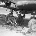 Airmen loading fresh oxygen cylinders into a Battle of No. 226 Sqn RAF at Reims Champagne