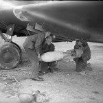 Armourers load a bomb into the Battle of No. 103 Squadron RAF at Betheniville