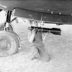 Armourer loads a 4.5 inch reconnaissance flare into the Battle of No. 218 Sqn at Auberives-sur-Suippes