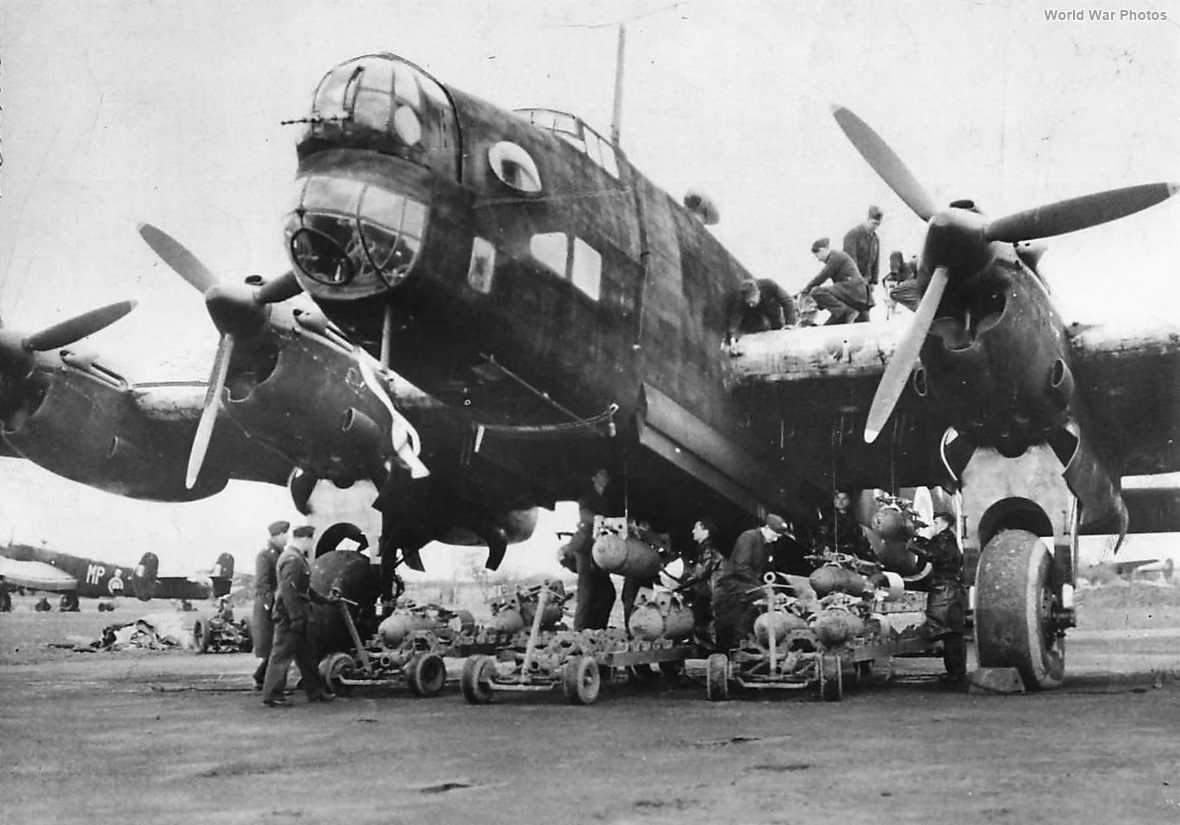 Crew loading bombs onto Halifax 76 Squadron 1941