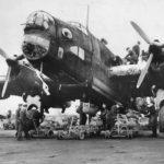Crew loading bombs onto Halifax 76 Squadron 1941