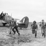 American pilots of No 71 Eagle Squadron rush to their Hurricanes at Kirton in Lindsey 17 March 1941