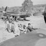 Armourers fit rocket projectiles to Hurricane Mk IV of No 170 Wing in a dispersal on an airfield in Burma