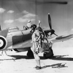 Flying Officer V C Woodward No 33 Squadron RAF beside his Hurricane Mk I Fuka Egypt 1941