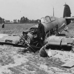 German soldier poses with destroyed Hurricane