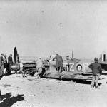 German soldiers inspect Hurricane Mk II code FZ-P of No 94 Squadron RAF shot down in North Africa