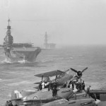 HMS Victorious flight deck showing HMS Indomitable and Eagle Sea Hurricane and Albacore are ranged on flight deck August 1942