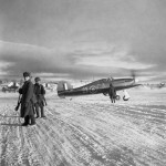 Hurricane Mk IIB Z5253 GA-25 of No 134 Squadron RAF taxies out past Russian sentries at Vaenga