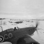 Hurricane Mk IIB of No 134 Squadron RAF scramble from their dispersals in the snow at Vaenga, Russia
