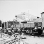 Hurricane Mk I L2045 code SD-A of No 501 Squadron RAF loaded onto a railway wagon during the final evacuation from France 1940