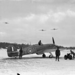 Hurricane Mk I of No 257 Squadron RAF fly over the airfield at Coltishall Norfolk V7607 code DT-H