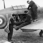 Hurricane pilot and ground staff inspect the oxygen supply of the aircraft before a sortie October 1940