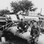 Luftwaffe soldiers poses with Hurricane wreckage