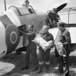 Mail being loaded into a Hurricane Mk IIC of No 1697 Air Despatch Letter Service Flight at B2 Bazenville Normandy 1944