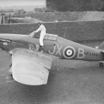 PO Clowes of No 1 Squadron RAF climbing into his Hurricane Mk I P3395, code JX-B in a revetment at Wittering