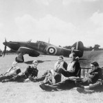 Pilots of B Flight No 32 Squadron relax on the grass at Hawkinge in front of Hurricane Mk I P3522, code GZ-V Battle of Britain