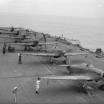 Sea Hurricanes of 885 Squadron FAA with their engines running ranged on the deck of HMS Victorious