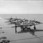 Sea Hurricanes of 885 Squadron ranged on the wet flight deck of HMS Victorious