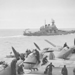 Sea Hurricanes on the flight deck of HMS Victorious with the battleship USS WASHINGTON in the foreground JULY 1942