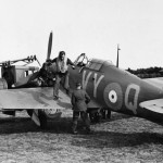 Sqn Ldr Peter Townsend jumps down from Hurricane Mk I P3166 VY-Q No 85 Squadron while being refuelled at Castle Camps July 1940
