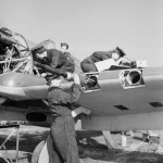 WAAF armourers and flight mechanics servicing a Hurricane at Sealand in Wales 5 May 1943