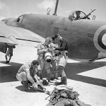 Crew of a Martin Maryland of No 39 Squadron RAF unship a Type F.24 aerial camera