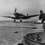 Batsman Guides Seafire Fighter on Deck of HMS INDOMITABLE