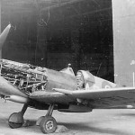 Supermarine Spitfire Fighter Parked by Hangar