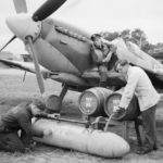 Spitfire's external fuel tank filled with beer from barrels before being flown to Allied forces in Normandy – June/July 1944