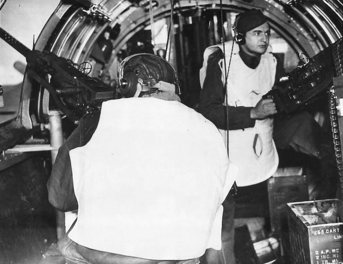 Waist gunners demonstrate flak jackets on B-17 Flying Fortress