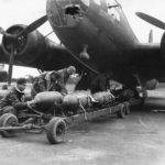 "Crew of 92nd Bomb Group loading bombs on B-17F 41-9148 ""Boomerang"""