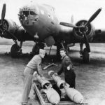 Ground crew loading bombs on Boeing B-17E in Australia