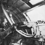 Waist gunner mans .50 caliber (12,7 mm) machine gun aboard B-17 Flying Fortress