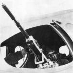 Waist gunner mans .50 caliber M2 Browning machine gun on Boeing B-17C