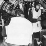 Waist gunners demonstrate flak jackets on B-17 Flying Fortress