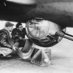 Ground crew loading 12,7 mm ammo in ball turret of B-17 bomber – England 1942