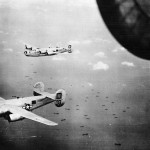 13th Air Force 5th Bomb Group 23rd BS B-24M Liberators #03 and #14 over Balikpapan October 1944