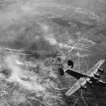 Aerial View of 450th Bomb Group B-24 Bombers Over Burning Target
