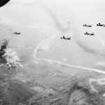 B-24 Bombers Leaving Smoking Target Area After Bombing