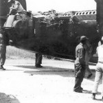 B-24 Liberator with Heavy Battle Damage to Tail Section