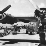 B-24 of 7th AF ground crews load bombers at a Marshall Islands airstrip for strike on Guam 1944