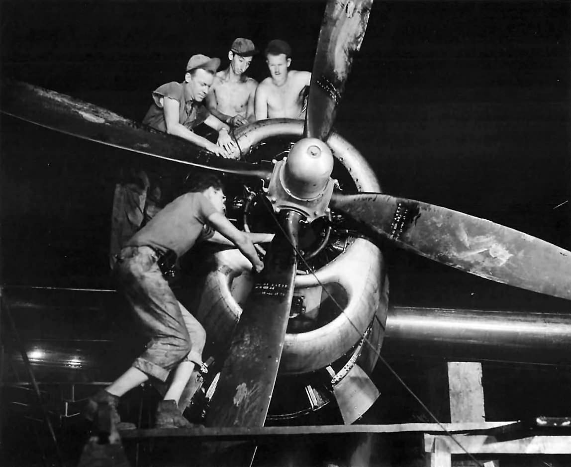21st BC crew working on engine of B-29 Superfortress. 1945