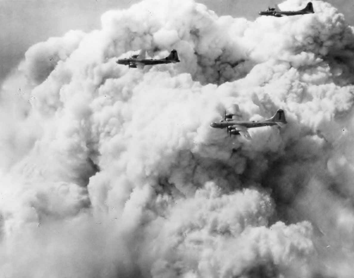B-29 Superfortress of the 498th BG Formation and Smoke Over Tokyo From Bombs