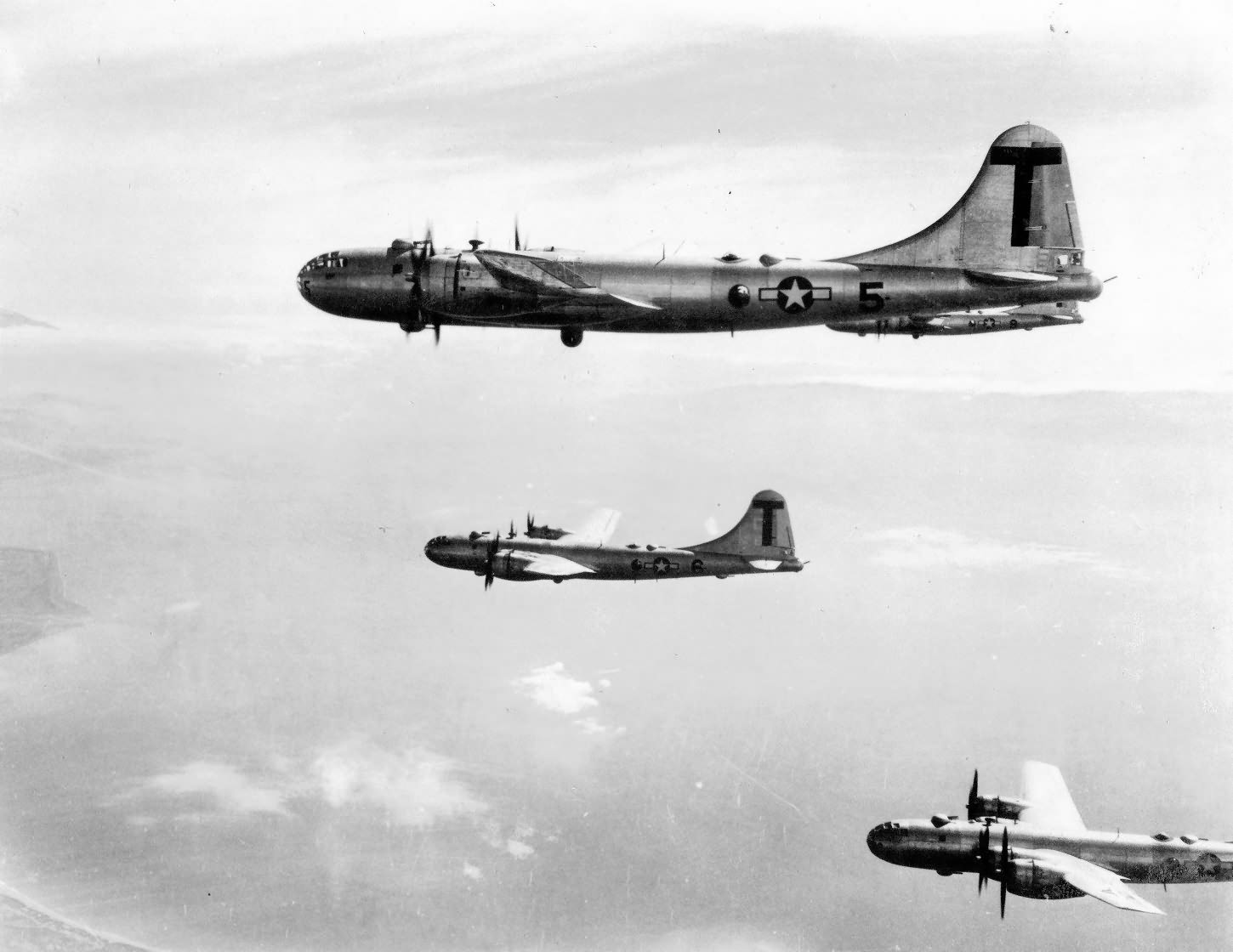 B-29 Superfortress T 5 and 6 from 499th Bomb Group fly into Japan