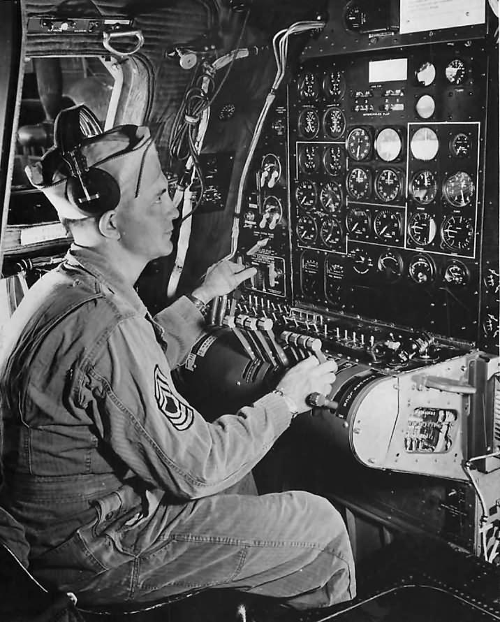Flight Engineer at instrument panel aboard Boeing B-29