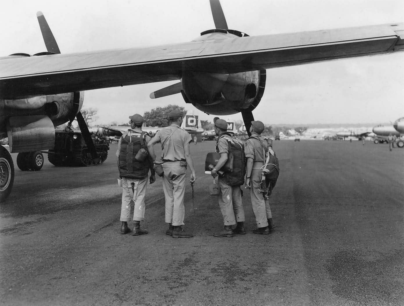 USAAF Crew Look at 29th bomb group Boeing B-29 Superfortress bombers GUAM