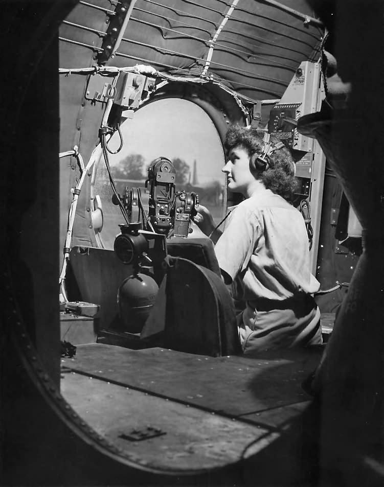 WAC in B-29 waist gunner's seat – Guam 1945