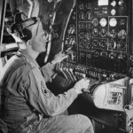 Flight Engineer at instrument panel aboard Boeing B-29