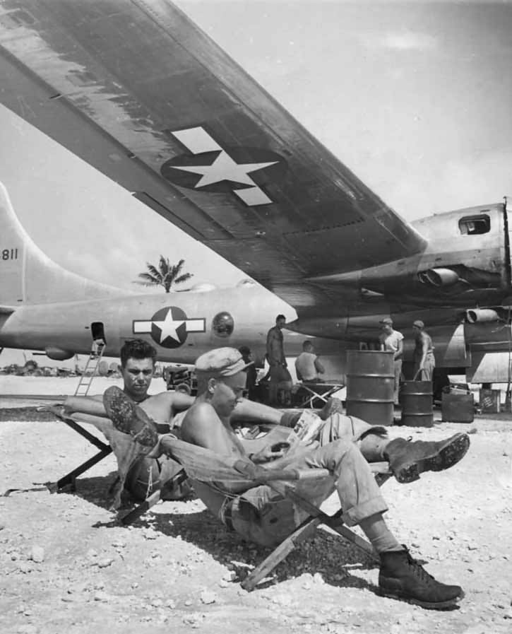 soldiers Rest Under Wing of Boeing B-29 at Marianas Base