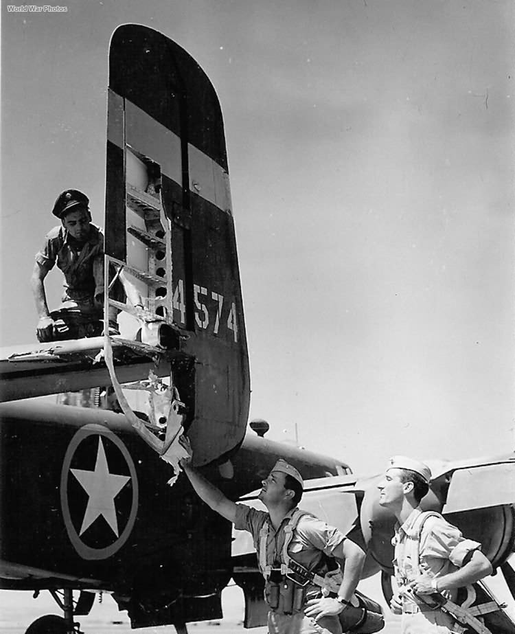 Aircrew checking out Flak damage on their B-25 '43